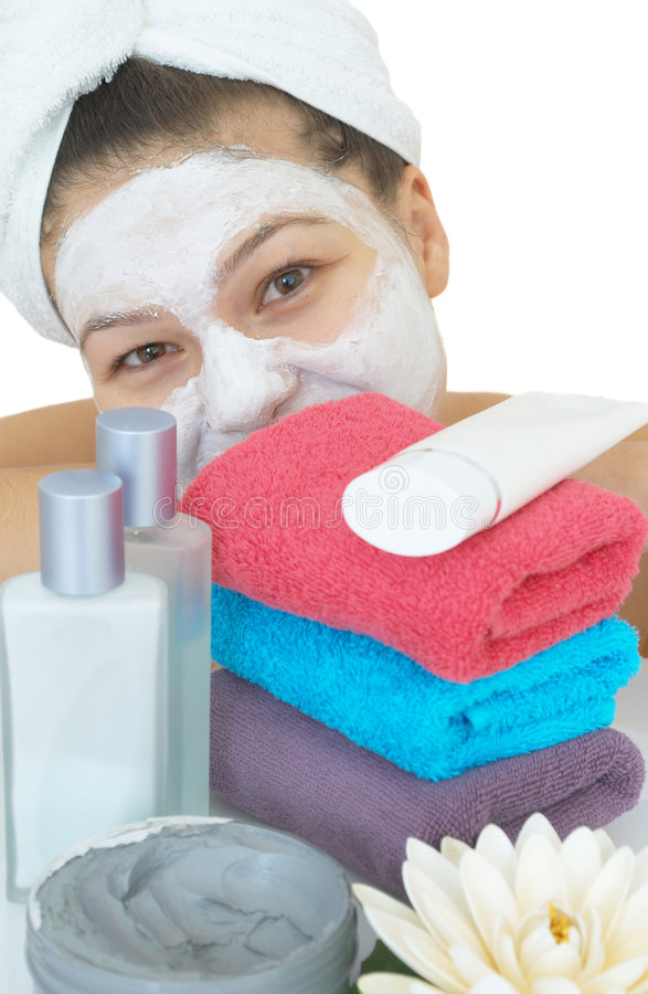 Happy skin care. Happy girl with a skin care massage royalty free stock images