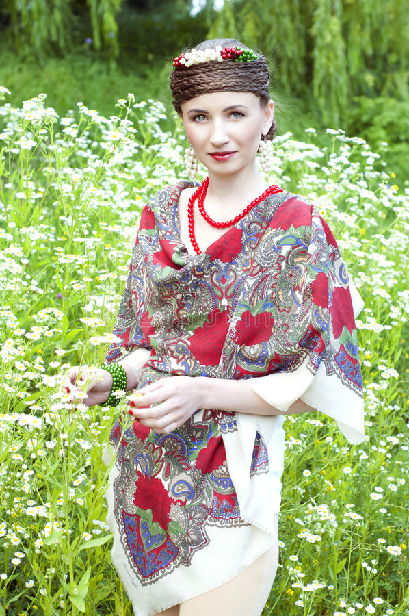Happy slavonic woman in the field royalty free stock photo
