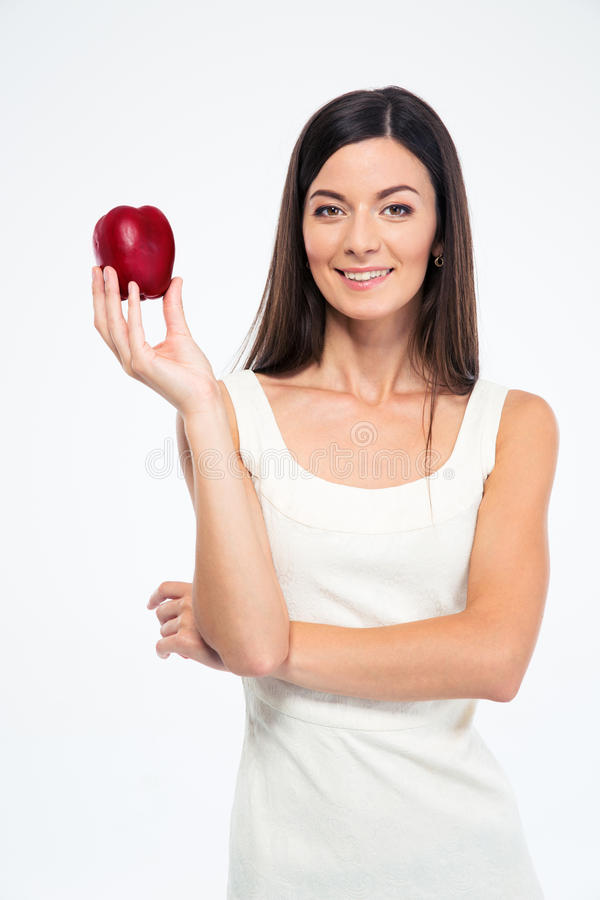 Happy slender woman holding apple stock photo