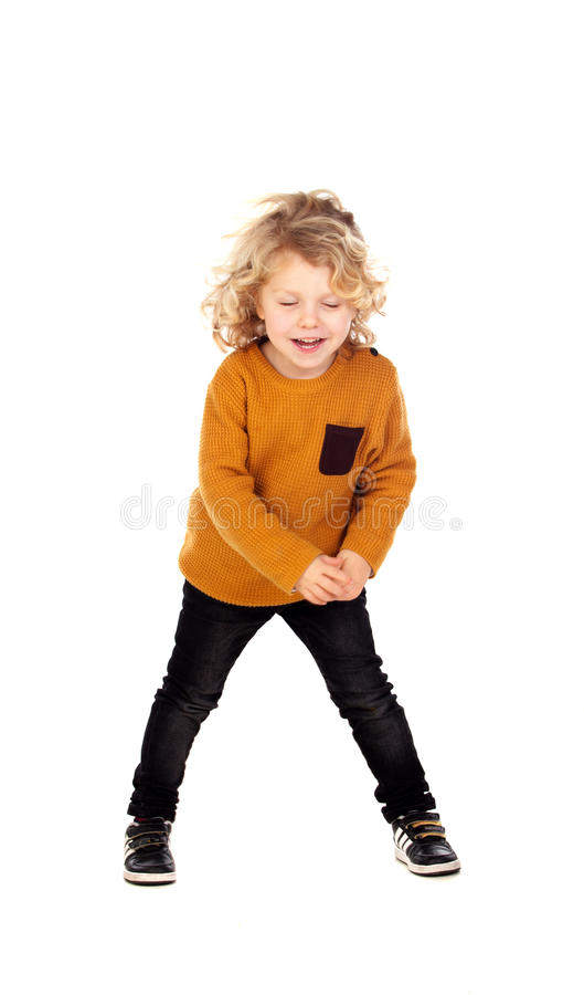 Happy small blond child whith yellow jersey royalty free stock photography