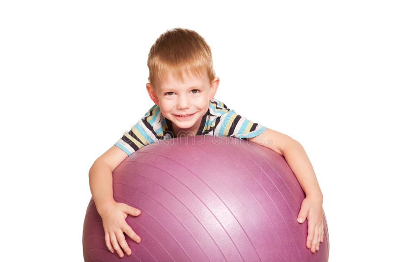 Happy Small Boy With The Fitness Ball. Royalty Free Stock Images