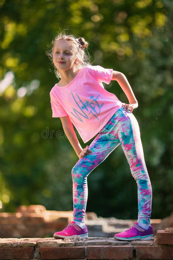Happy small child jumping active for pleasure. Active and energetic girl having fun in summer. The concept of sports, dance, hip royalty free stock photos