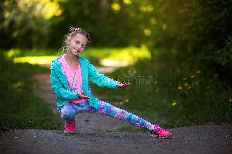 Happy small child jumping active for pleasure. Active and energetic girl having fun in summer. The concept of sports, dance, hip royalty free stock photo