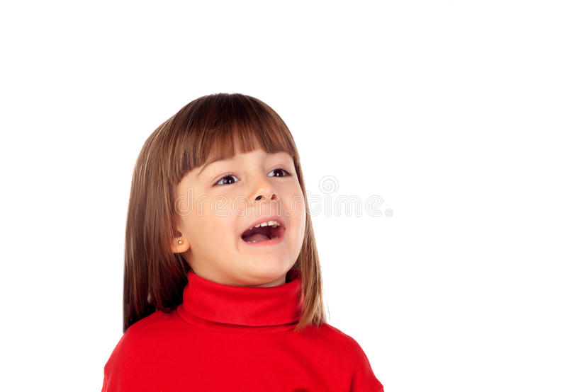 Happy small girl looking up stock images