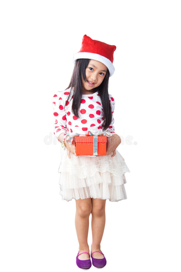 Happy small girl in Santa hat have a Christmas stock images
