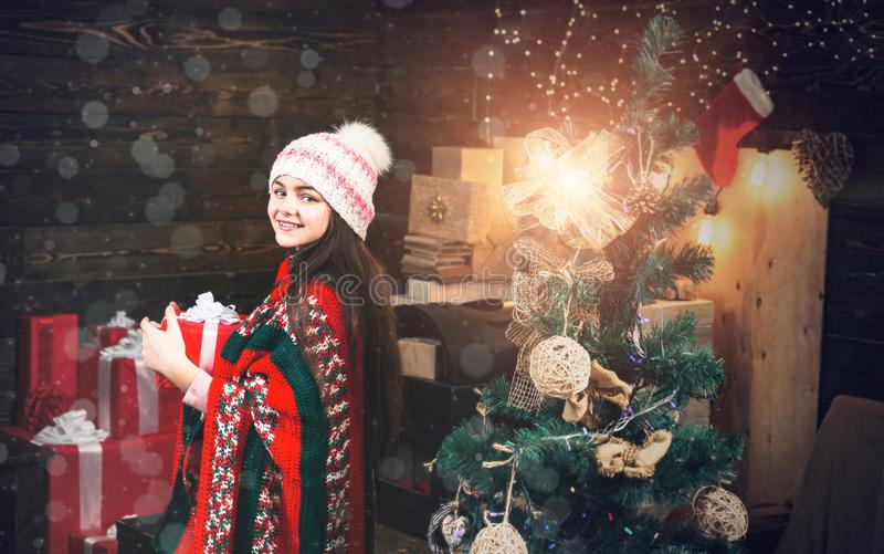 Happy small teenager in Santa hat with present have a Christmas. Happy new year. Winter kids. Christmas Xmas winter royalty free stock image