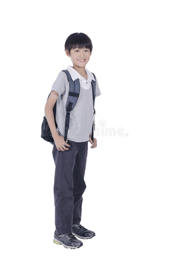 Happy smart boy ready for school. Over white background royalty free stock photo