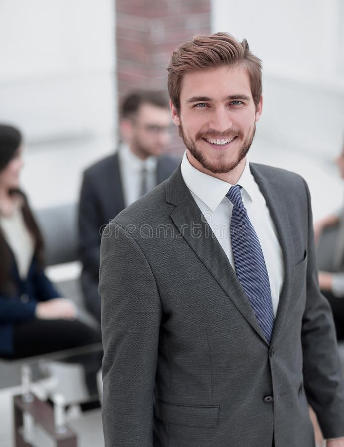 Handsome business man working at the office. Happy smart business men with team mates discussing in the background stock images