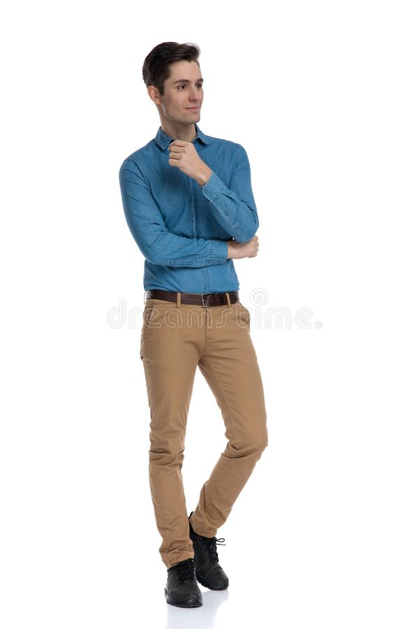 Happy smart casual man looking to side and walking stock photography
