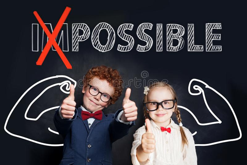 Happy smart kids little boy and girl showing thumb up against text possible on chalkboard background royalty free stock photo