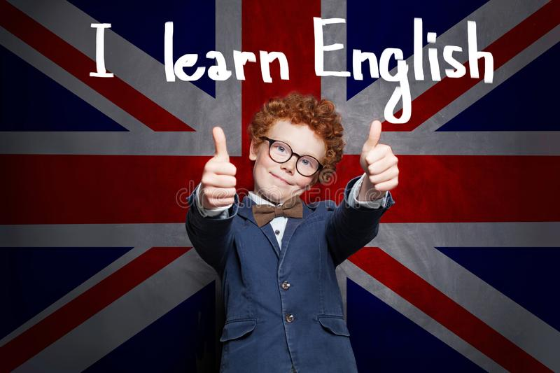 Happy smart successful child boy is ready for English exam. Learn English concept.  stock images