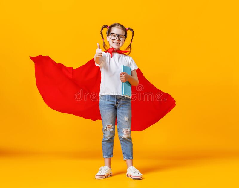Happy smart superhero showing thumb up stock images