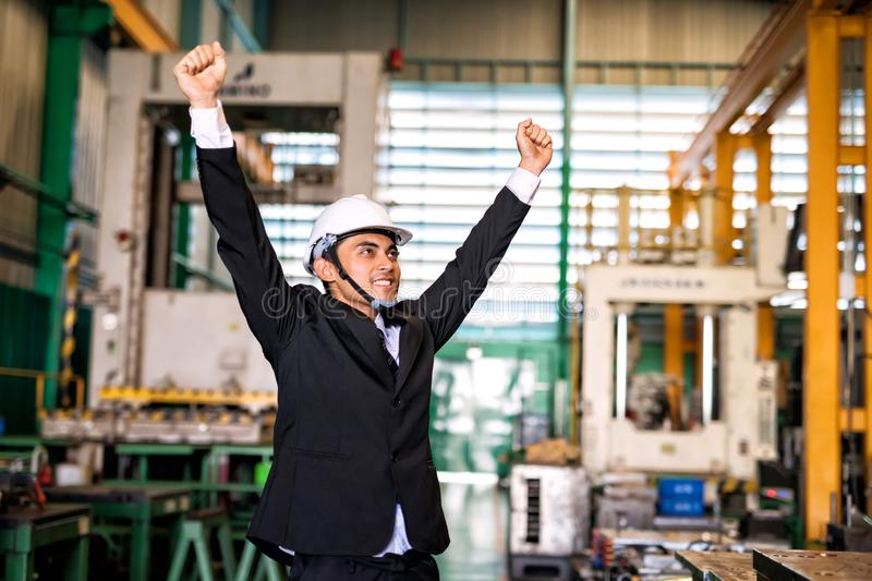 Happy businessman celebrate in factory royalty free stock photo