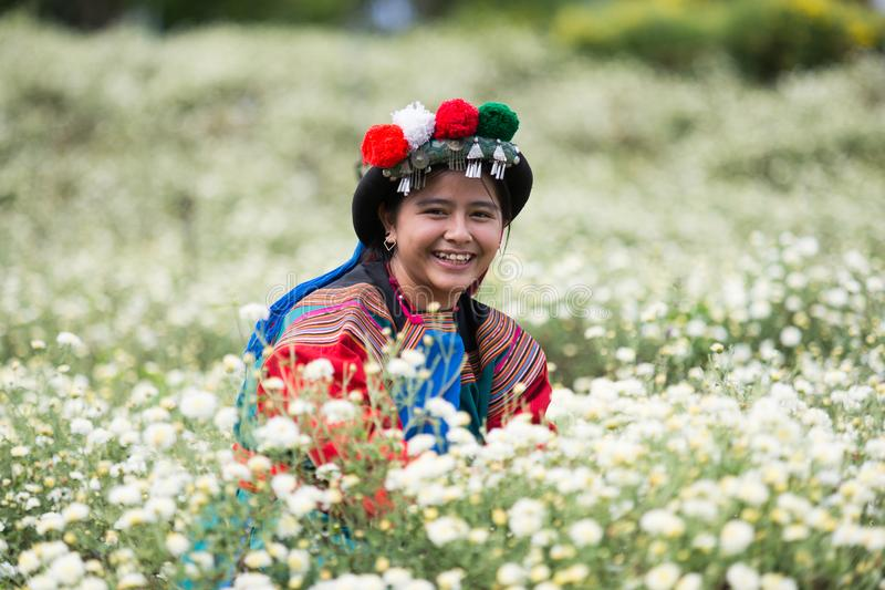 Happy smile hill tribe Chrysanthemum garden. Happy smile hill tribe in Chrysanthemum garden with colorful costume dress stock images