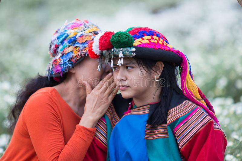 Happy smile hill tribe whispering bad news stock images