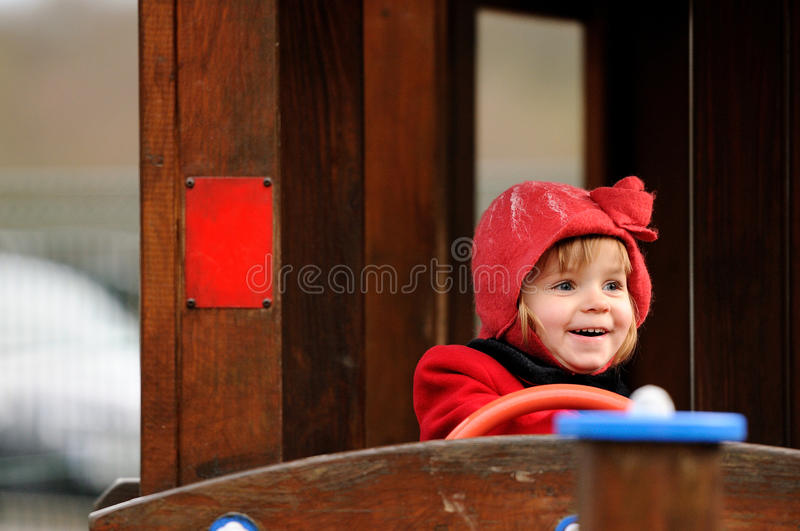 Happy Smile. A little girl laughing while playing in a playground royalty free stock photography