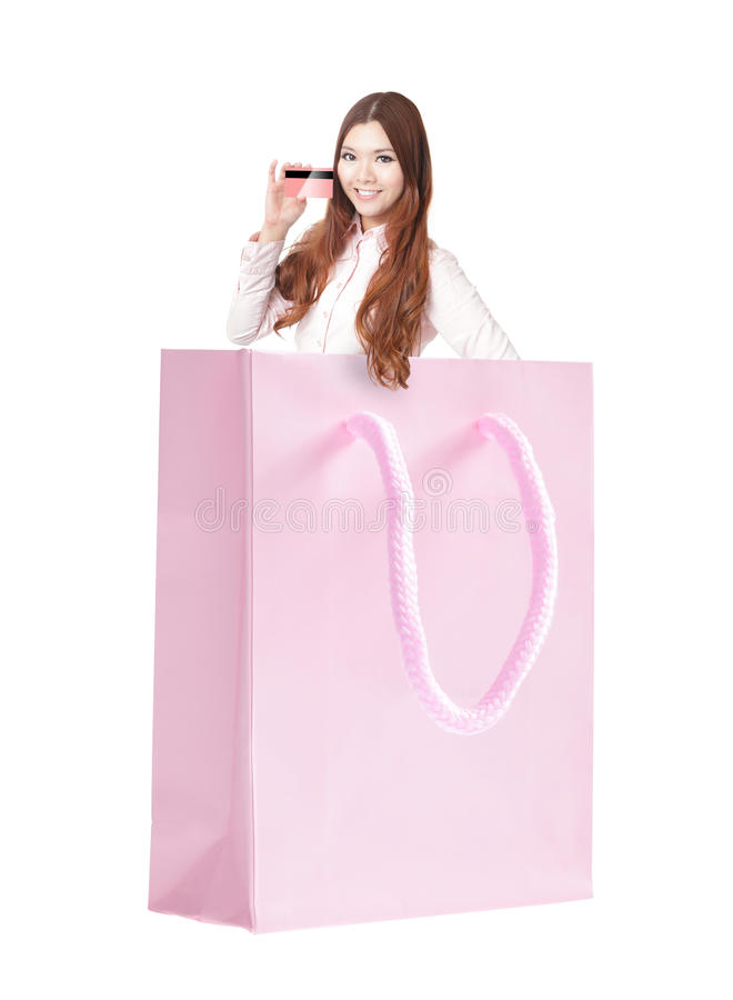 Smile woman holding credit card in the shopping bag stock images