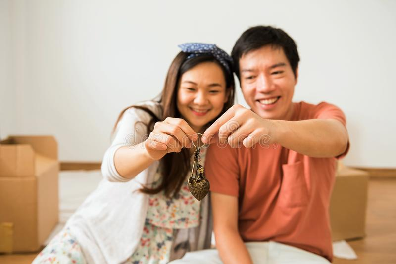 Happy couple holding key of new house royalty free stock photo