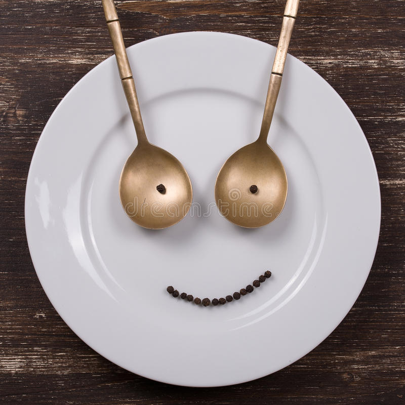 Happy smiley face. On dish plate stock photos