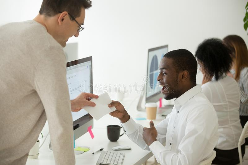 Excited black worker rewarded with money bonus for good work stock photography