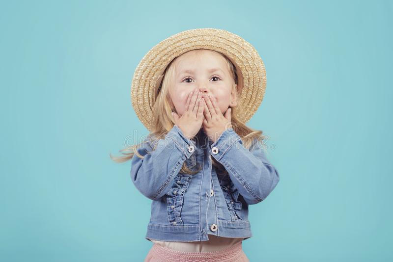happy and smiling baby with hat on blue background royalty free stock images