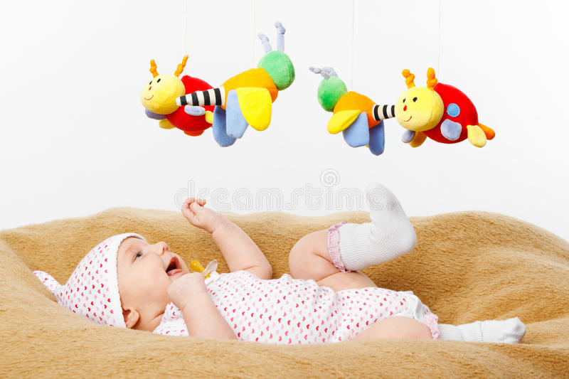 Happy smiling Baby Playing with toys stock images