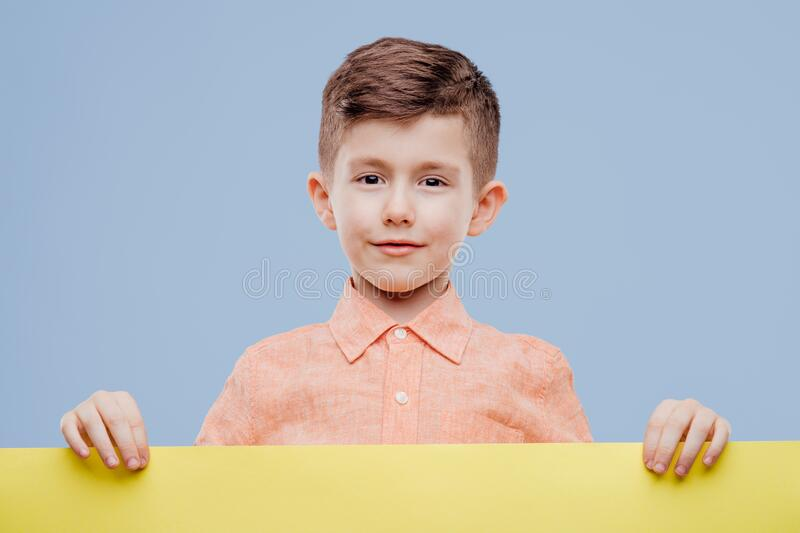 Happy smiling beautiful child showing blank signboard stock photography