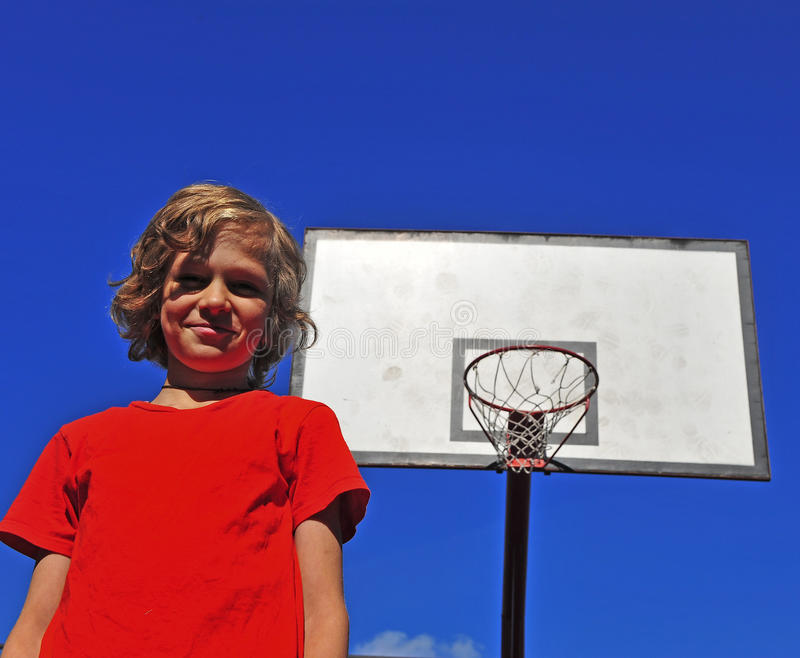 Happy smiling boy with basketball hoop on background. Happy smiling boy with the basketball hoop on background stock image