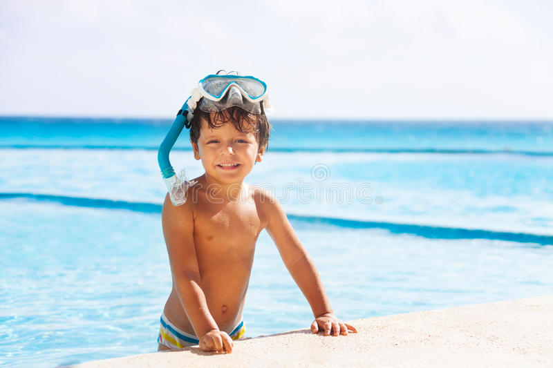 Happy smiling boy with snorkel mask on his head stock photography
