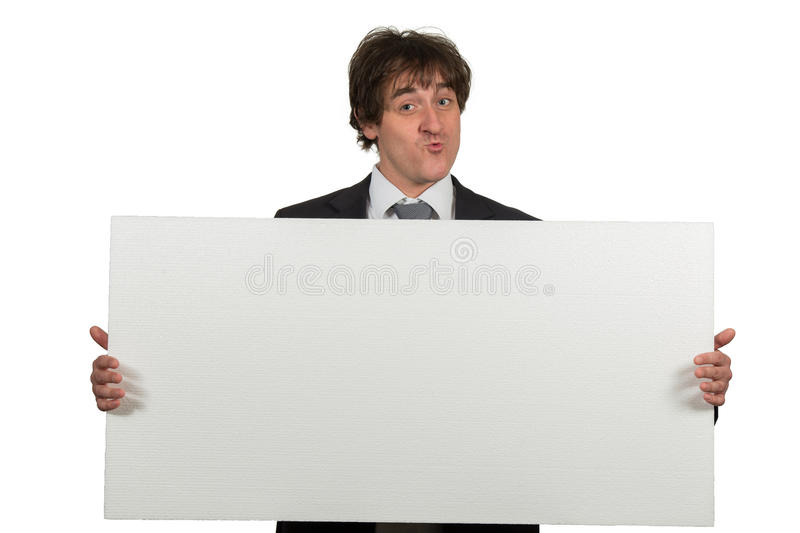Happy smiling business man showing blank signboard, isolated over white background.  royalty free stock photo