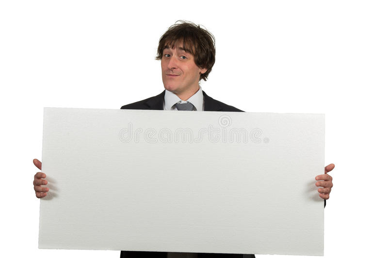 Happy smiling business man showing blank signboard, isolated over white background.  stock image