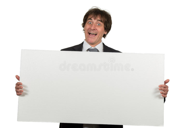 Happy smiling business man showing blank signboard, isolated over white background.  stock photos
