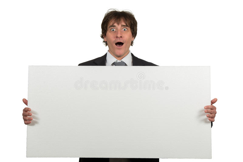 Happy smiling business man showing blank signboard, isolated over white background.  stock photo