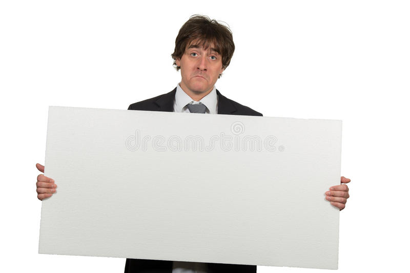 Happy smiling business man showing blank signboard, isolated over white background.  stock images