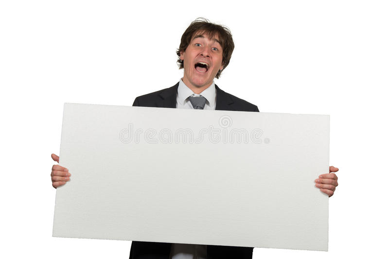 Happy smiling business man showing blank signboard, isolated over white background royalty free stock images