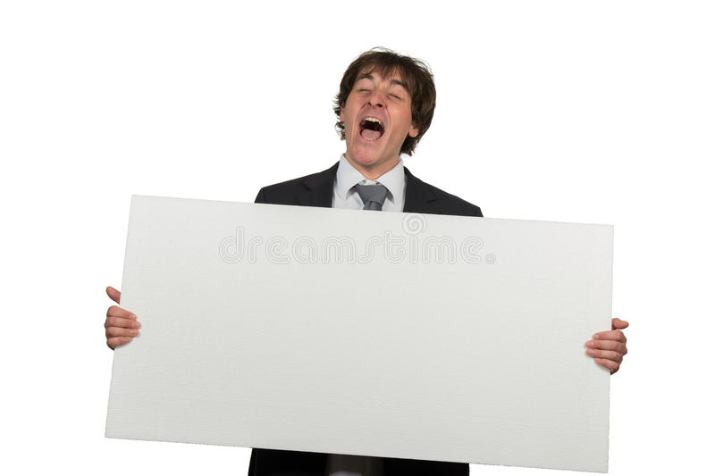 Happy smiling business man showing blank signboard, isolated over white background.  stock photography