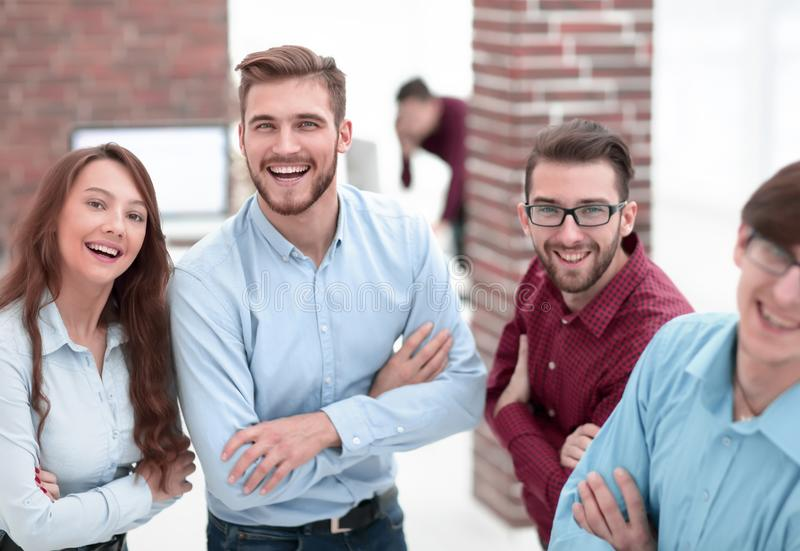 Smiling american team discussing business project during coffee. Happy smiling business team in office royalty free stock images