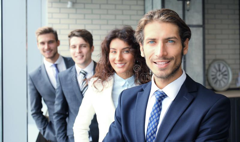 Happy smiling business team standing in a row at office. stock images