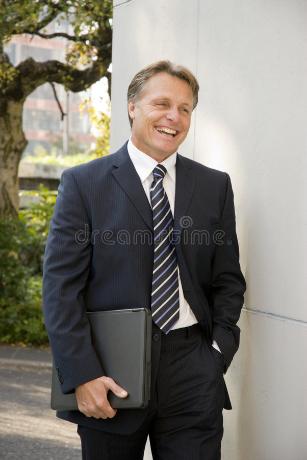 Happy smiling businessman stock images