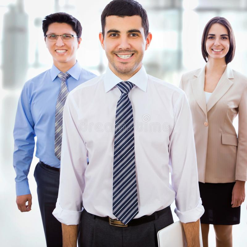 Business team standing in a row stock images