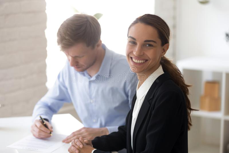 Happy smiling businesswoman making good business deal. Looking at camera. Attorney legal consultation, lawyer and client. Successful business, sales, purchase stock photography