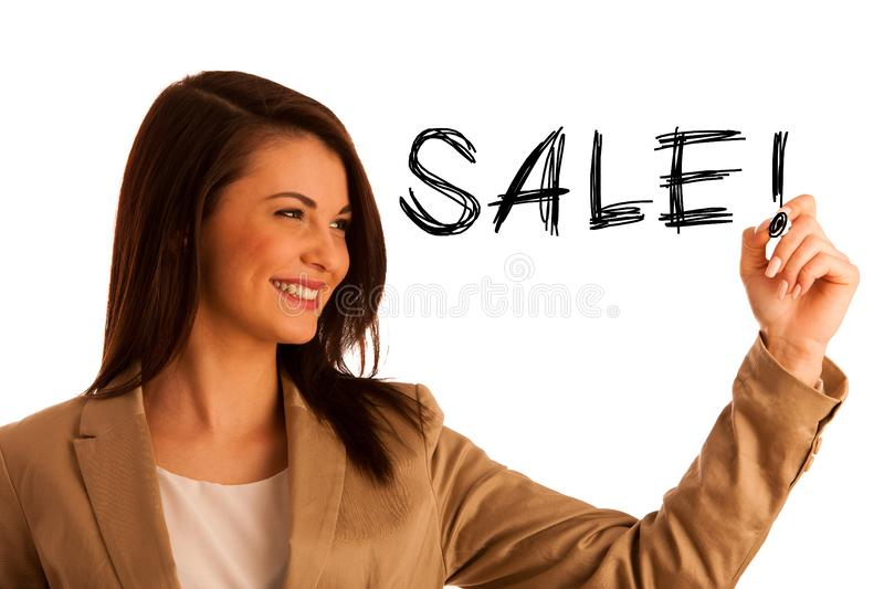 Happy smiling cheerful beautiful young business woman writing or stock photo