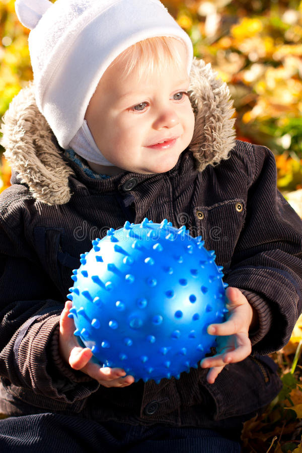 Download Happy Smiling Child With Blue Ball In His Hands Stock Image - Image: 23550211