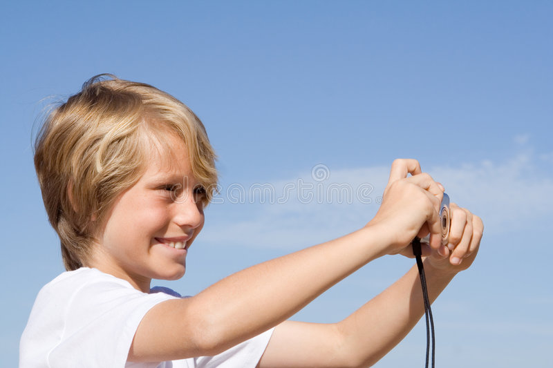 Happy smiling child with camera royalty free stock image
