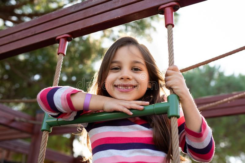 Happy Smiling Child Girl Playing At Playground stock photo
