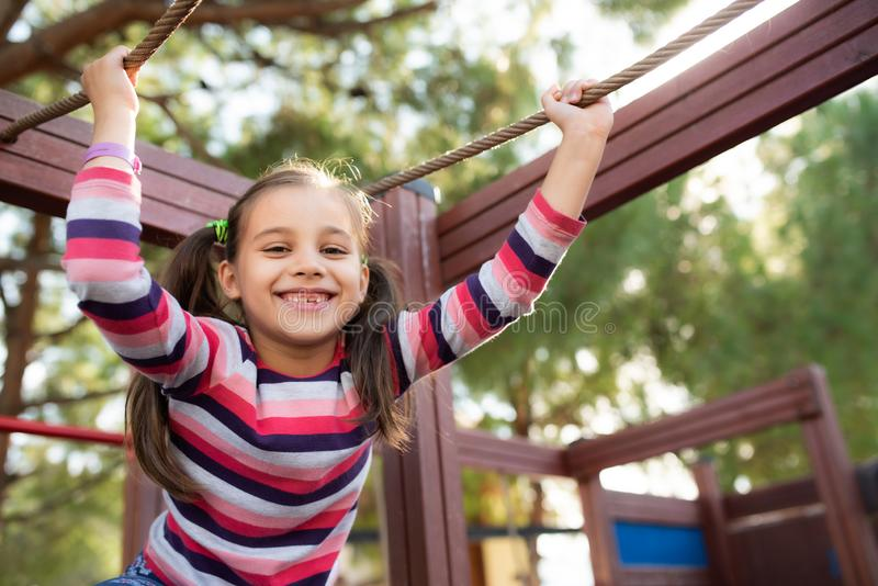 Happy Smiling Child Girl Playing At Playground stock image