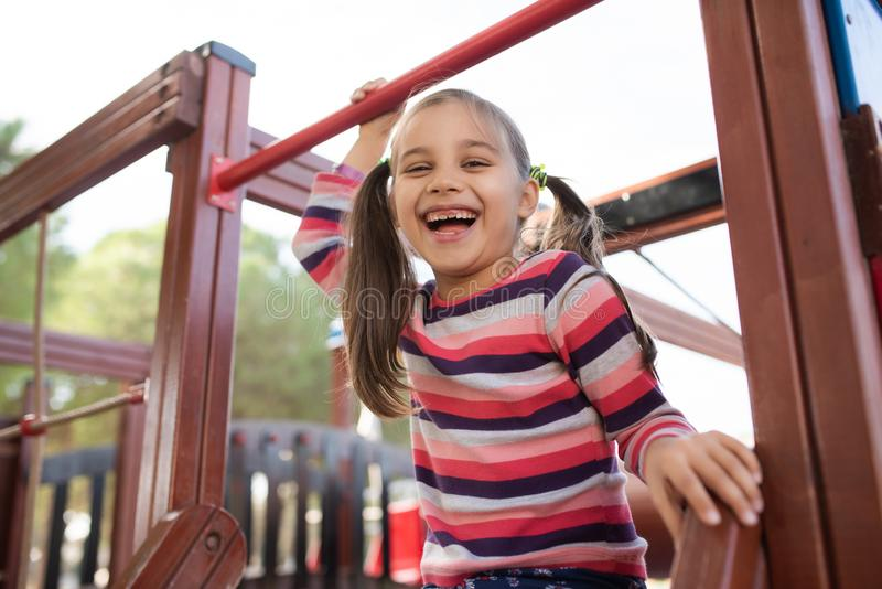 Happy Smiling Child Girl Playing At Playground stock photos