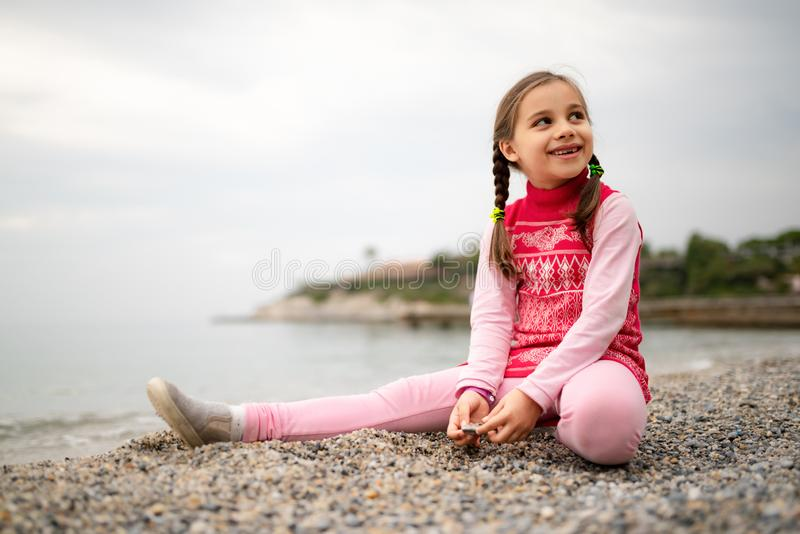 Happy Smiling Child Girl Playing At Seaside royalty free stock images