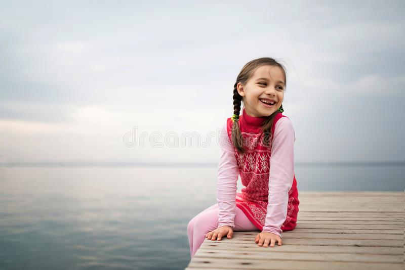 Happy Smiling Child Girl Playing At Seaside stock photography