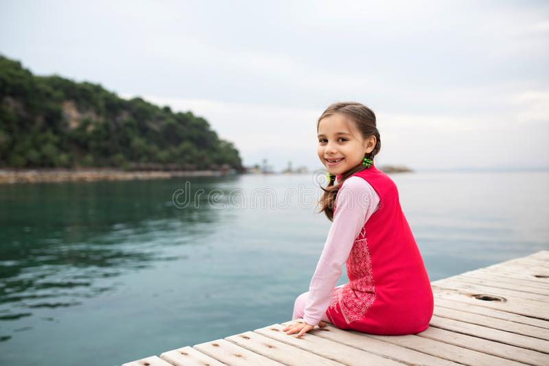 Happy Child Girl Playing At the Seaside. Happy Smiling Child Girl Playing At the Seaside stock photography